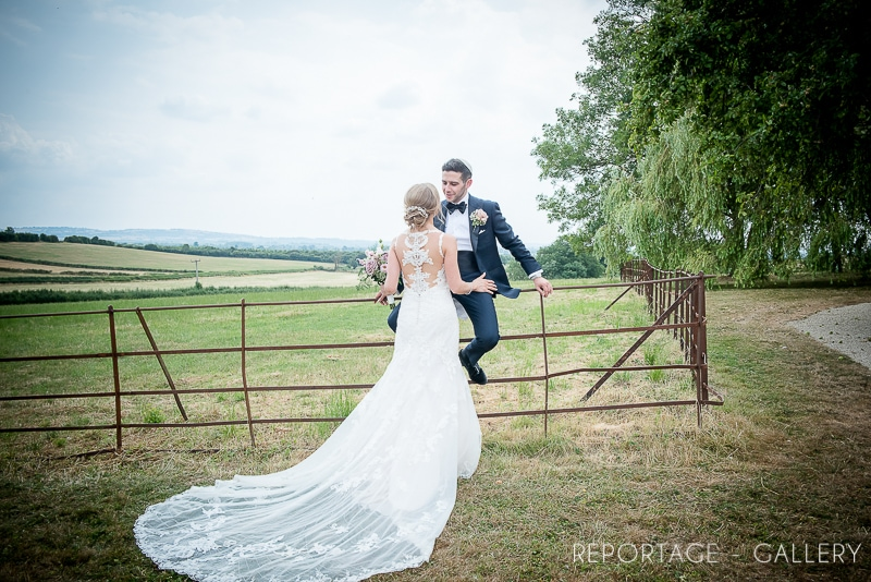 poundon-house-exclusive-weddings-events-retreats-venue-groom-sitting-on-garden-fence